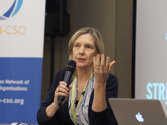 Photo of Lyn from the australian multicultural foundation speaking with a microphone